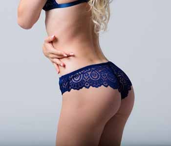 Dr. Edmund Kwan uses implants or fat for buttock augmentation in New York.